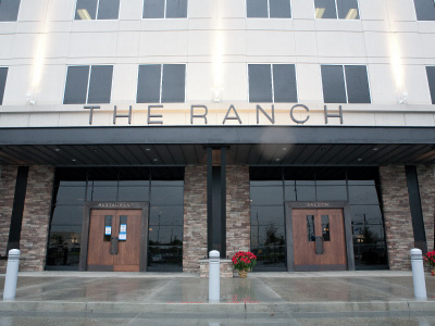 A closeup of the outside, daytime view of the main entrance to THE RANCH Restaurant & Saloon.