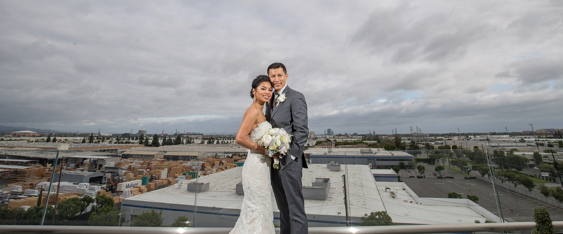 A bride and groom pictured on the balcony