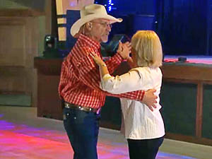 Couple enjoying a two-step country dance lesson.