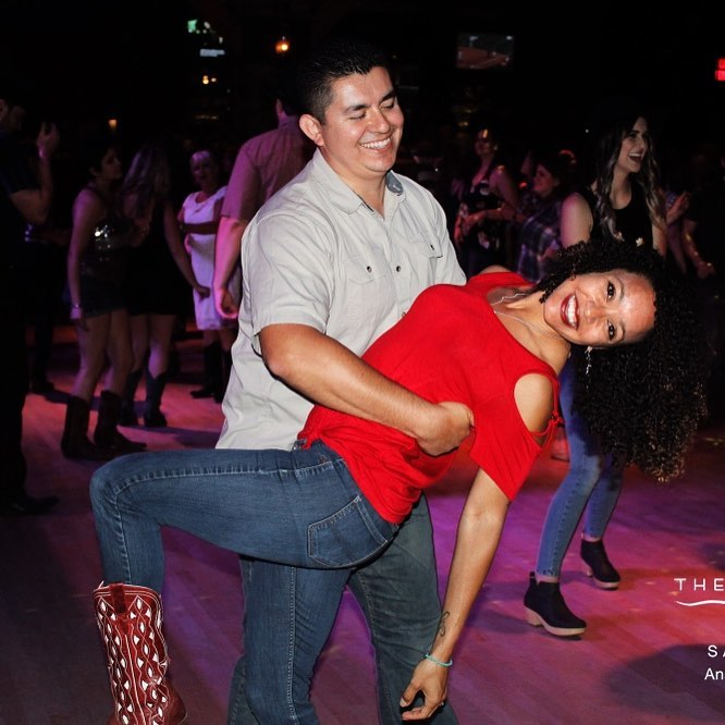 A couple doing a dip on a dance floor.