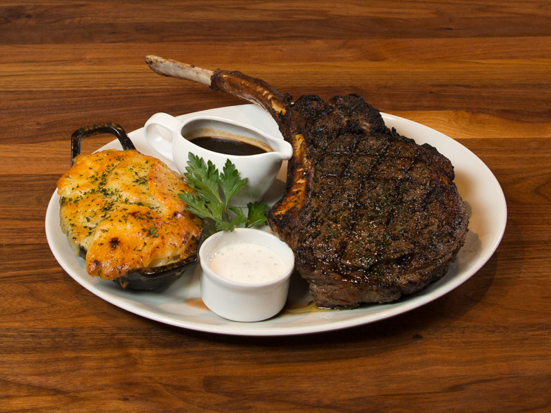 Juicy, bone-in ribeye steak chop served with creamy white-cheddar scalloped potatoes and Bordelaise sauce.