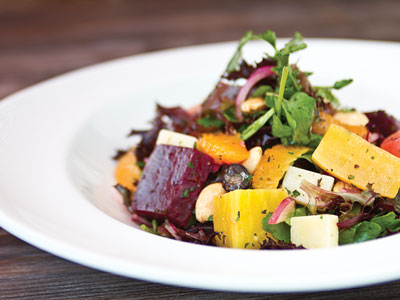 Bountiful salad of heirloom beets in varied colors, Lolla Rossa lettuce, orange slices, red grapes & Spanish Manchego cheese.