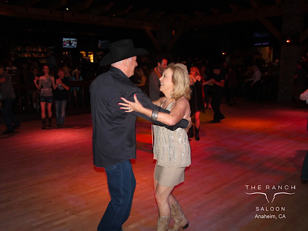 Andrew Edwards and his wife, Morgan, dancing the West Coast Swing at The RANCH Saloon.