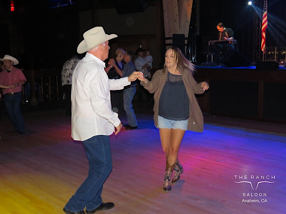 Andrew Edwards country dancing at the Saloon with his daughter, Ashton