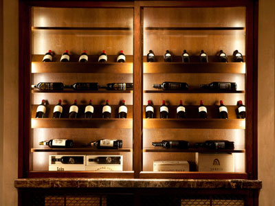 A wine cabinet containing various bottles of wine.