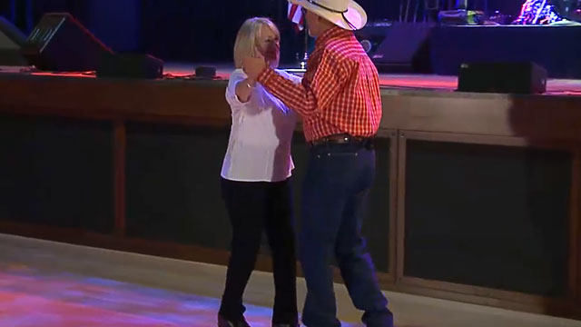 Video of the country dancing instructor and his partner performing the two-step to music.